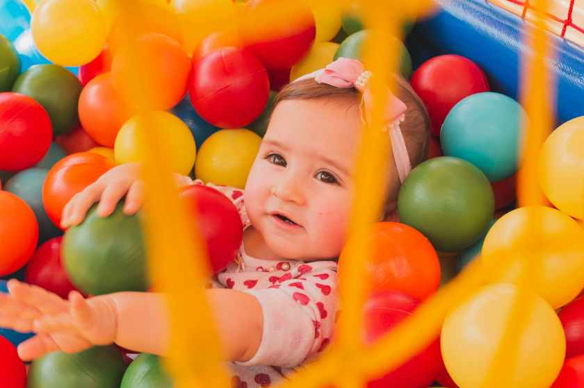 toddler girl s in pool ball